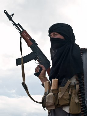 Muslim rebel with rifle stock vector