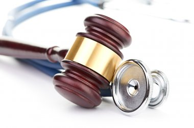 Brown gavel and stethoscope