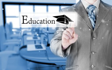 business man pointing education concept