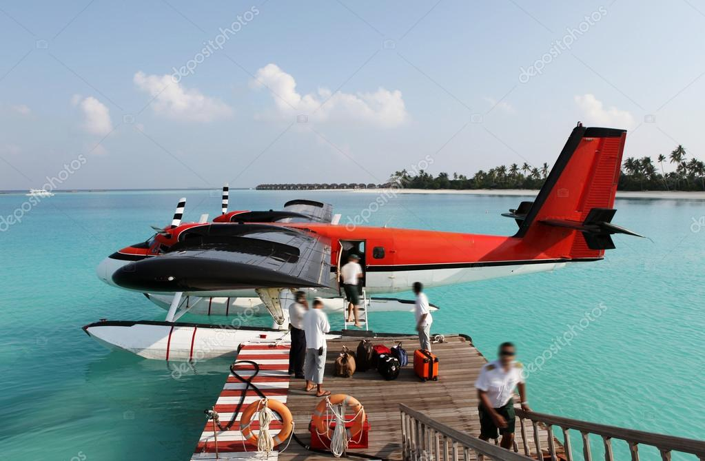 Red seaplane at the docks of an exotic resort in Maldives