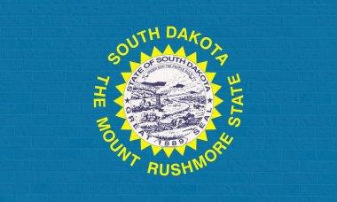 South Dakota state flag on brick wall