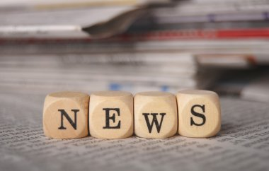 The word news on cubes