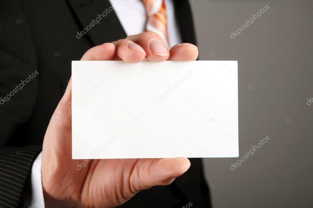 Business man offering card