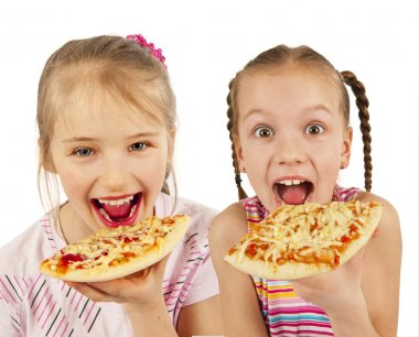 Young girls eating pizza