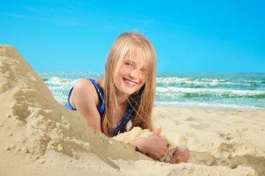 little girl on a sandy beach