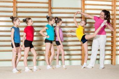 coach teaching little girls