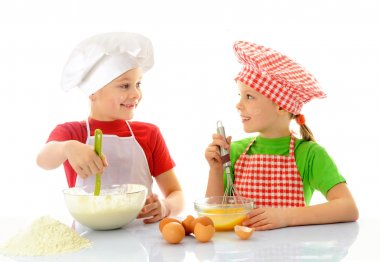 Happy little chefs preparing dough