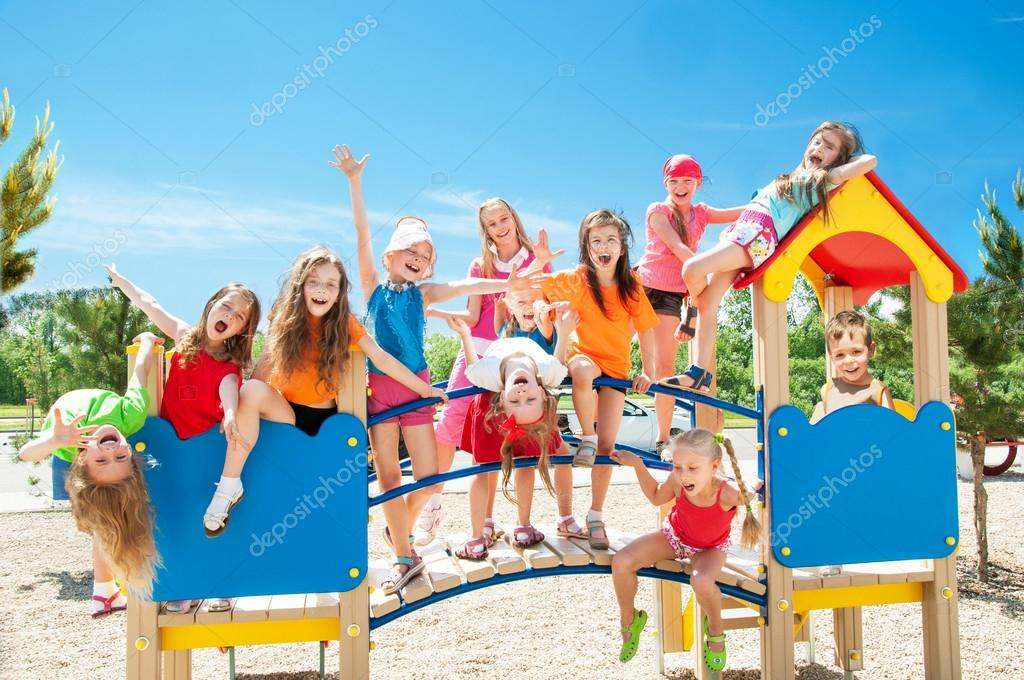 Happy kids playing on playground