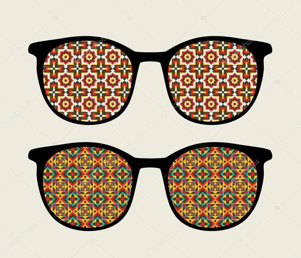 Retro sunglasses with ornament reflection in it.