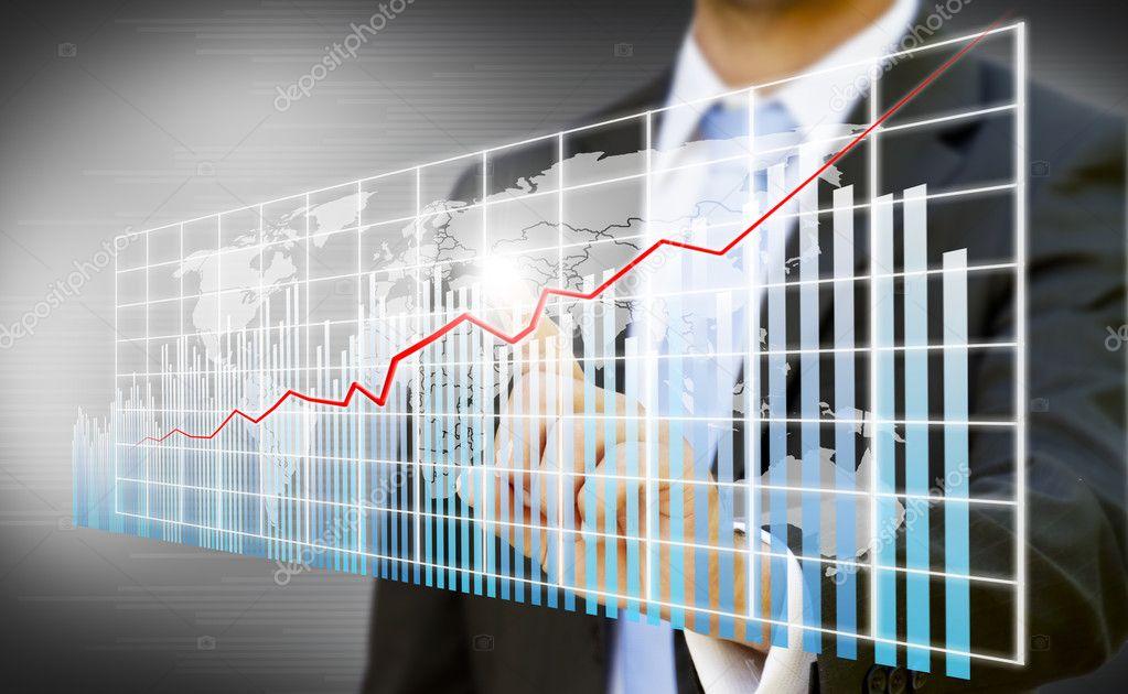 Businessman creating digital charts