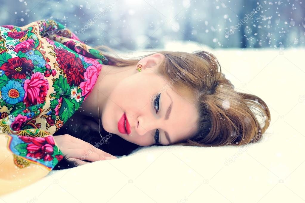 Young beautiful woman on snow