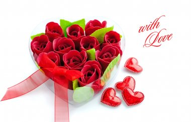 Heart-shaped box with red roses on white background