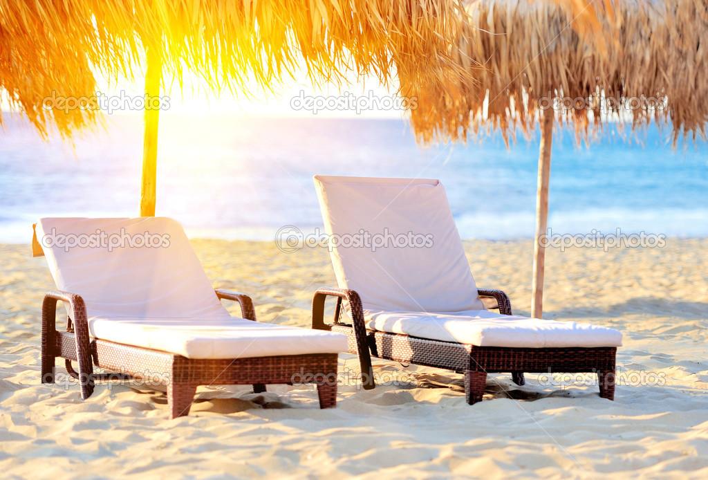Two Beach Chairs With White Umbrella Stock Photo
