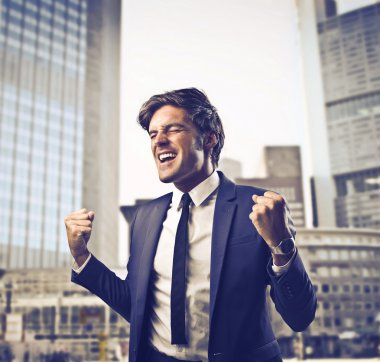 Businessman rejoicing for his success in a street stock vector
