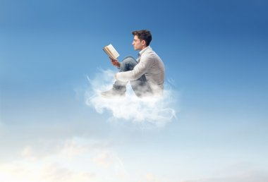 Man reading on a cloud stock vector