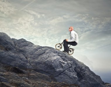 Businessman riding a bike