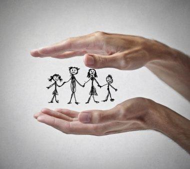 Family between two hands