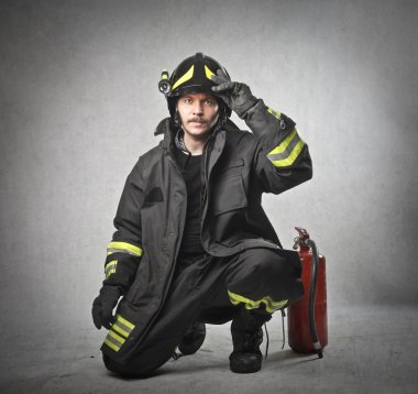 Fireman putting on his helmet