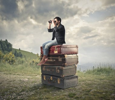 Man looking through a binoculars on some suitcases stock vector