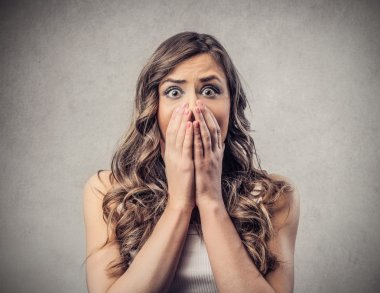 Scared astonished woman