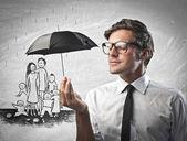 Fotografie Geschäftsmann hält einen Regenschirm