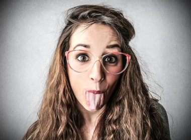 Young woman stucking out her tongue