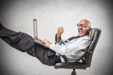 Businessman relaxing and cheering