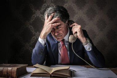 Desperate elegant man speaking at the phone