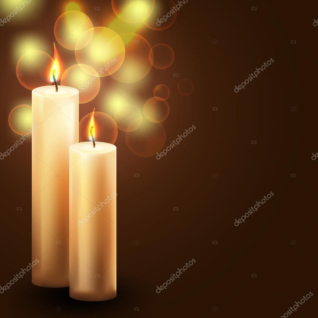 Two candles on blurry holiday background