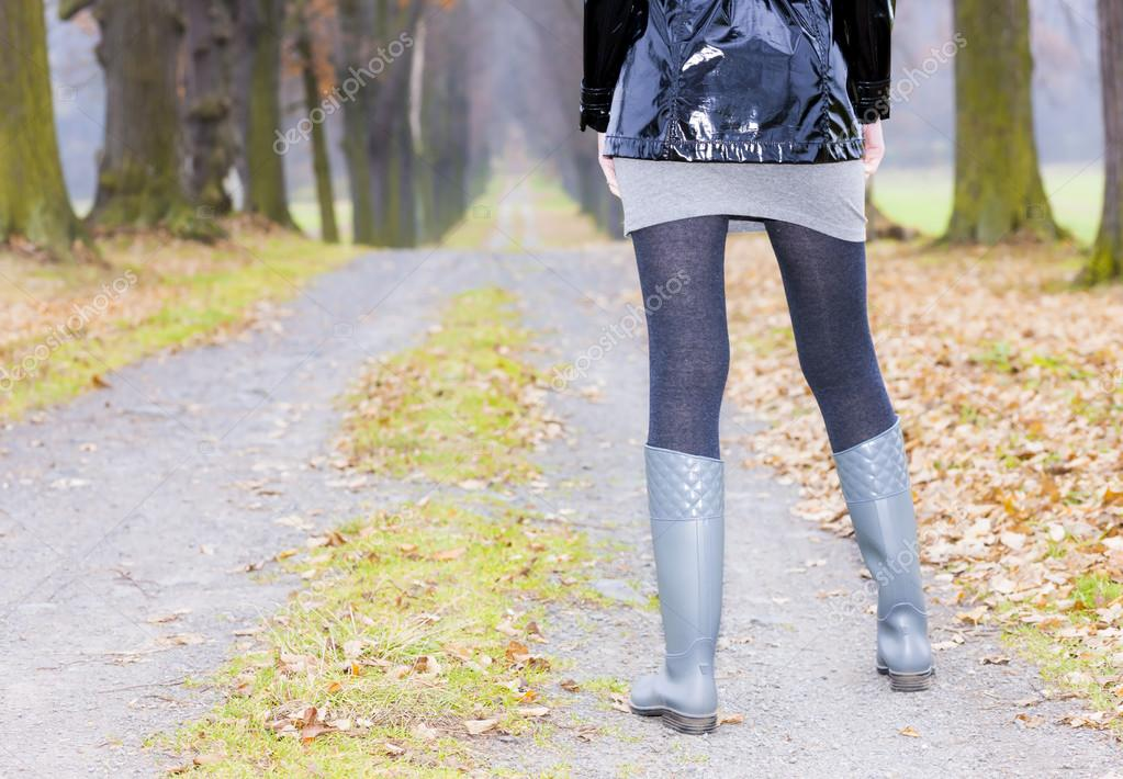 detail of woman wearing rubber boots
