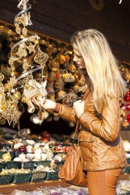 Woman at Christmas market, Vienna, Austria stock vector