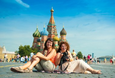 Happy young woman lying on Red Square