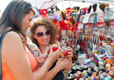 Female tourists choosing souvenirs