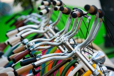 A lot of bicycle handlebars