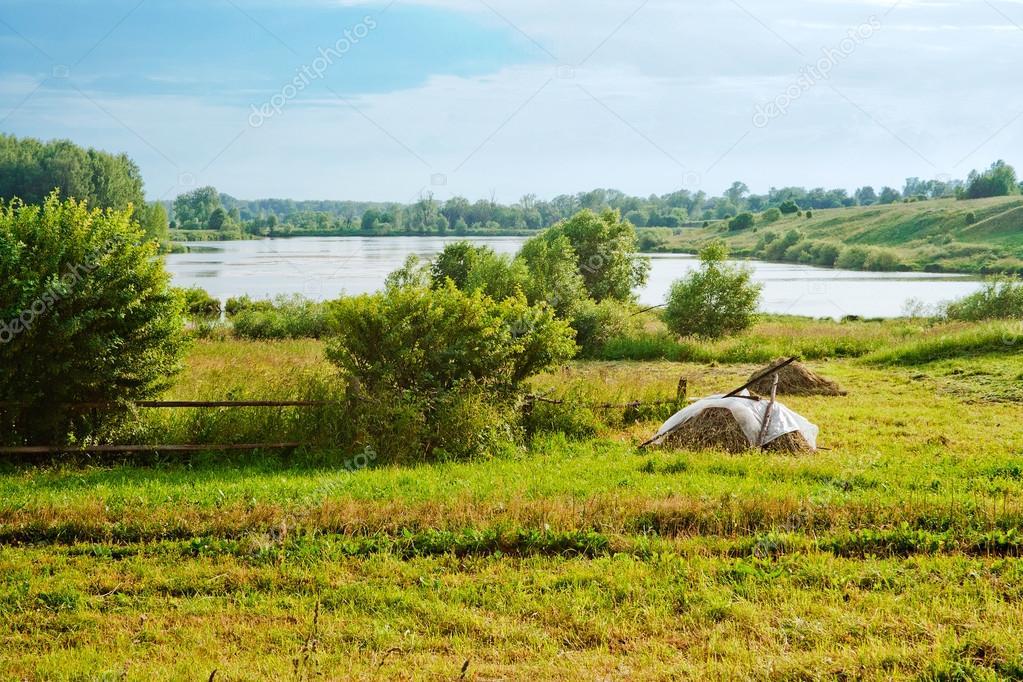 Haystacks and lake