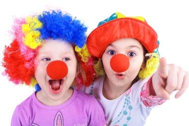 Little girls playing clowns