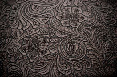 Image of dark brown floral design engraved leather stock vector