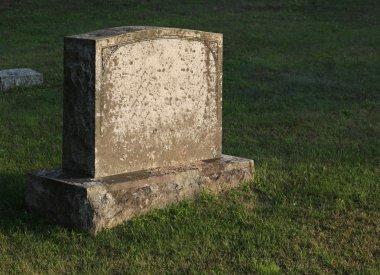Sun-cast Tombstone