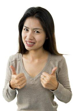 Beautiful asian woman with braces