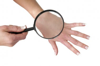 Hand, magnifying glass and skin stock vector