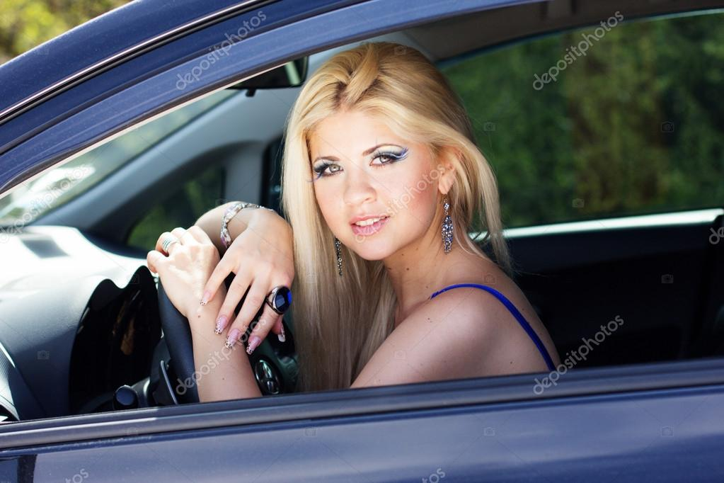 Nice Stock Photo Her Car With chupacabra — © Blonde Girl 43040113