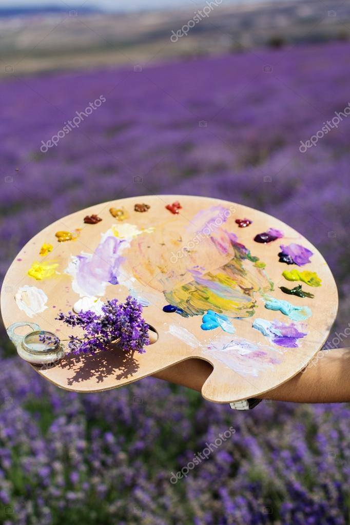 Young artist painting in lavender field