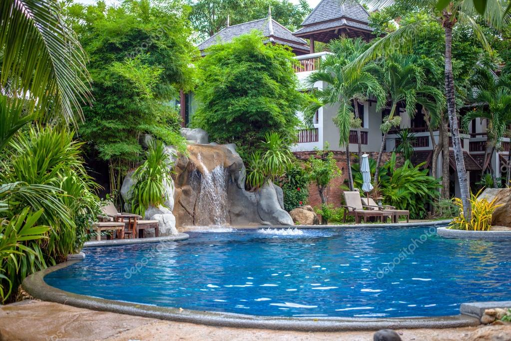 Tropical waterfall landscape in spa resort