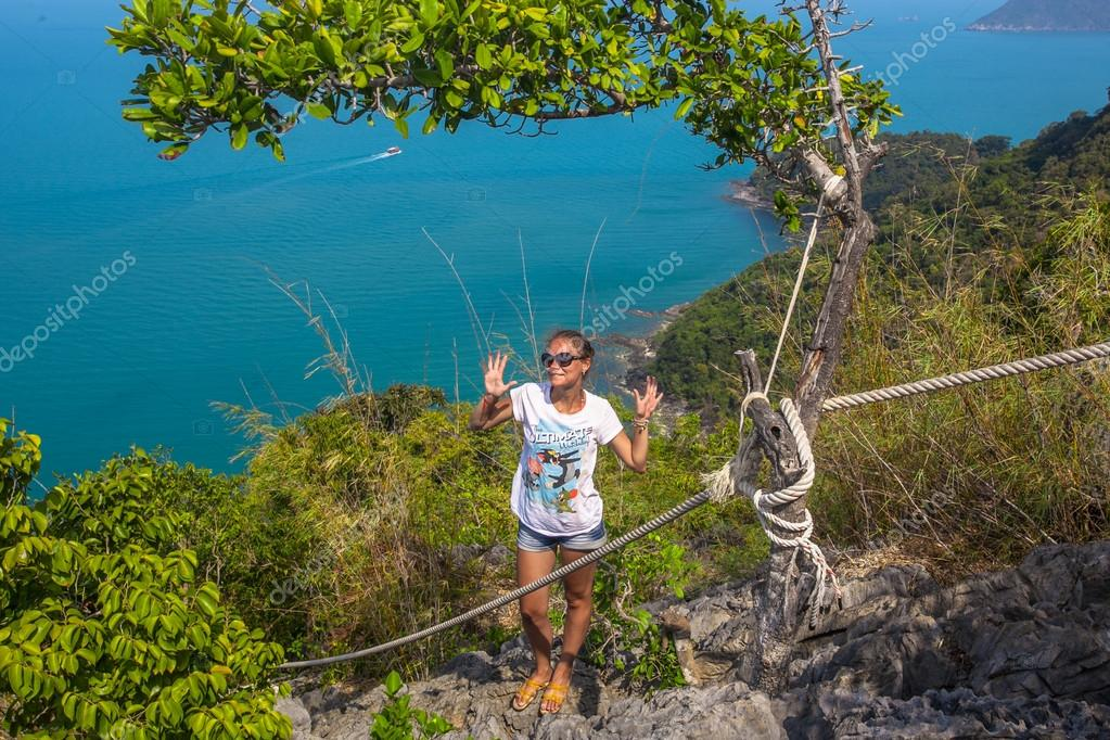 View from mountain on  Angthong Marine National Park and posing woman