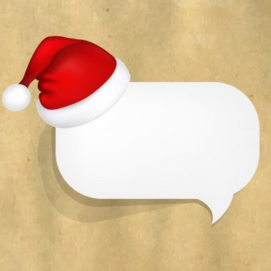 Cardboard Structure With White Paper Speech Bubble And Santa Hat