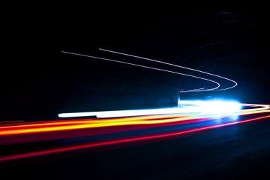 Car light trails. Art image. Long exposure photo taken in a tunn