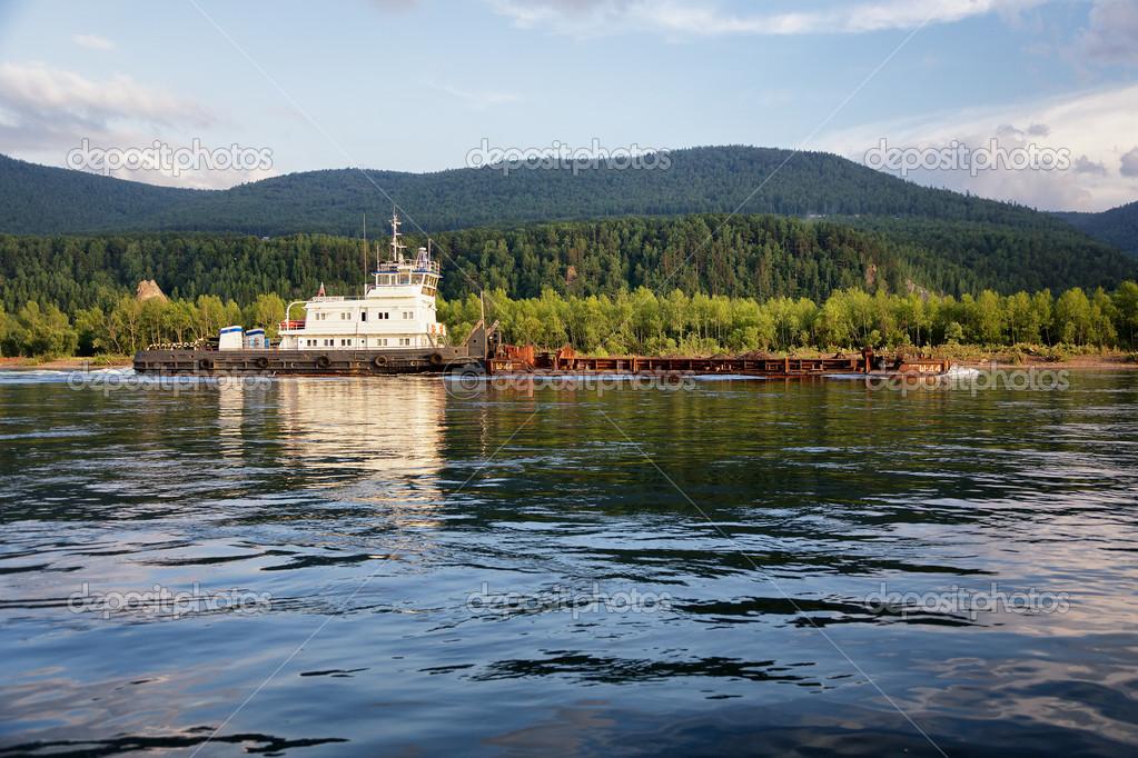 Tugboat pulling a barge