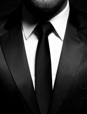 Gentleman in black suit and tie