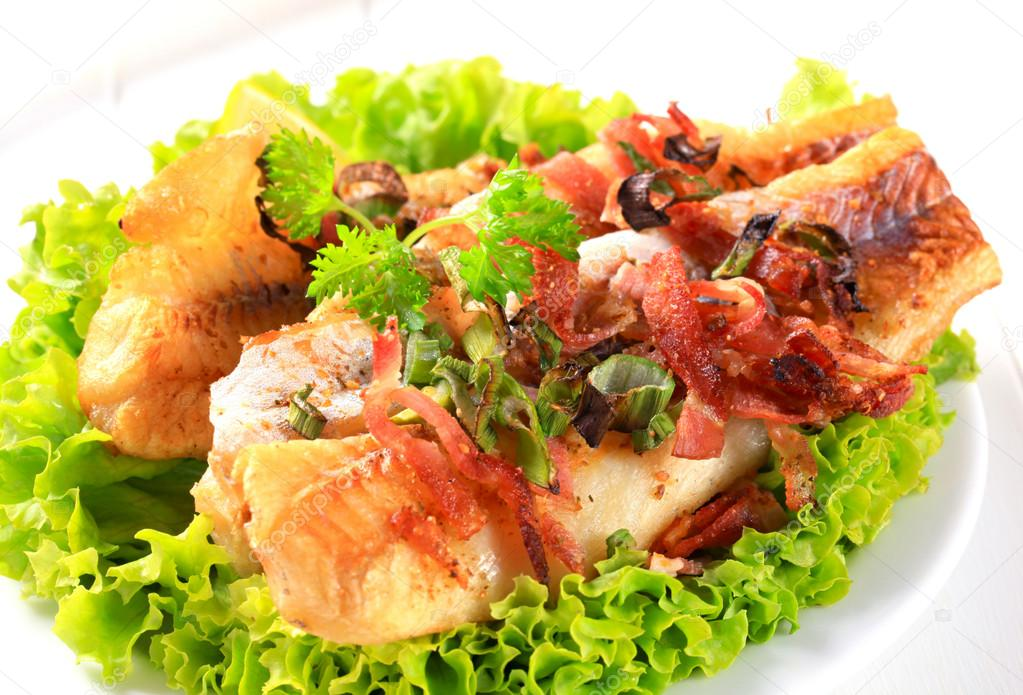 pan fried fish pan fried fish fillets with bacon bits stock photo 11771