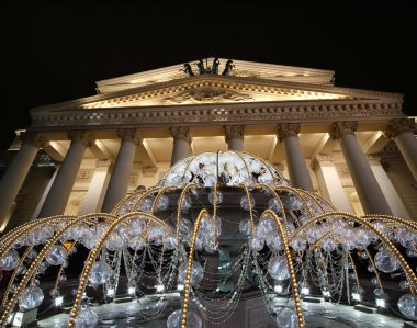 Bolshoi Theatre(Large, Great or Grand Theatre, also spelled Bolshoy) at night in Moscow, Russia, seen behind the fountain, lighted during christmas